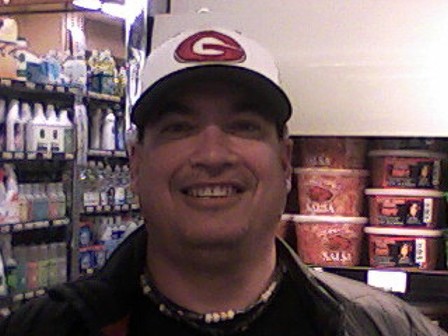 Gunn softball coach Matt Maltz near the knish section of Piazza's