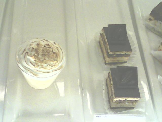 """With apologies to both Wayne Thiebaud and John McCrea, here are the Tres Leches treat and Opera almond cakes from Coupa, although the rock band Cake claims their name denotes a dense quality like when your boot sinks into the mud and emerges """"caked"""""""