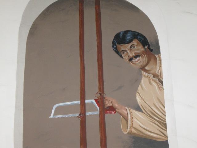 Greg Brown mural in Roxy Rapp building, above elevator