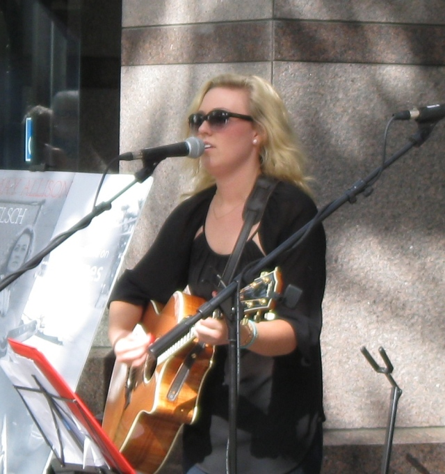 Gunn grad gone country Hannah May Allison in front of Lululemon, at Palo Alto World Music Day, 2014