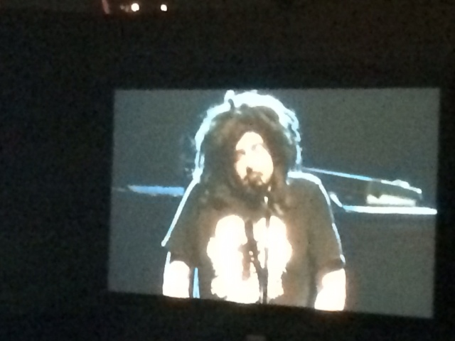 This is a photo of a tv screen in LA last weekend,  of Berkeley kid, Adam Duritz, the voice of my generation. But what's that thing alighted on his noggin?