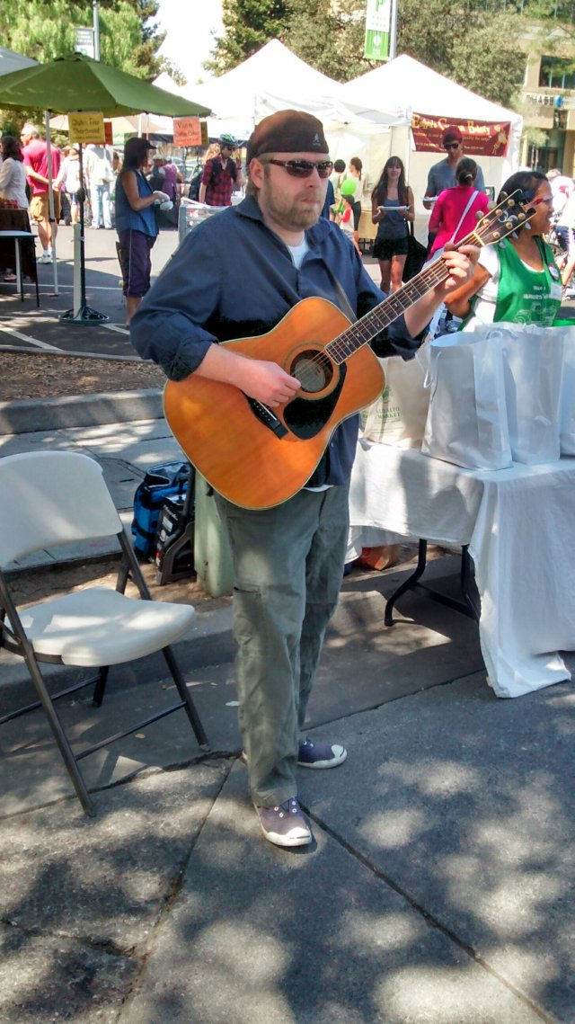 "HIS TIME IS GONNA COME - I spoke for 40 minutes Saturday with this guitarist, subbing for the entertainment at Palo Alto Famers Market, who is also a tenants rights activist in East Palo Alto, and plays a decent version of Sublime, ""what I got"" and Led Zed."