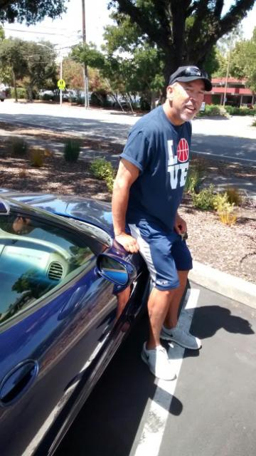 Hans Delannoy, his blue vette, at Charleston Center, August, 2014