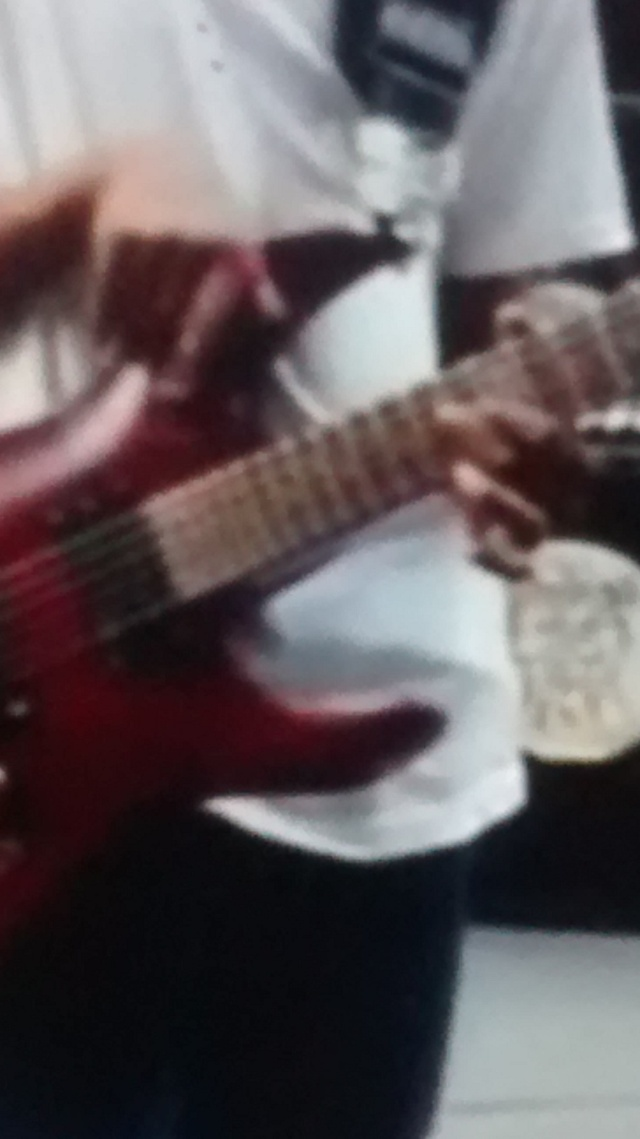 Screen grab of Malcolm Brickhouse, guitar, in 2013 busking at Times Square