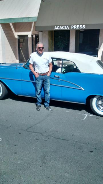 A guy named Mario, and his 1955 or 1954 blue, American beauty; note the Ferrari t-shirt, State Street Los Altos, August, 14, 2014