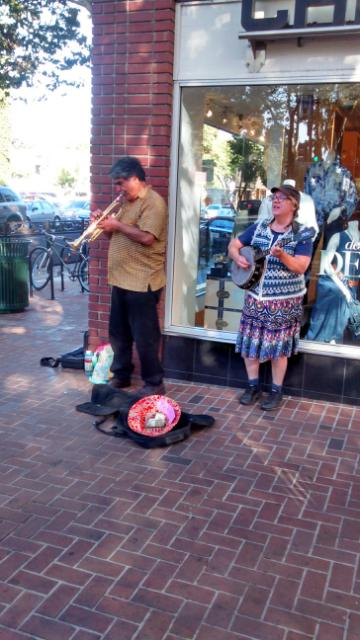 I have these two, shot on University Avenue in Palo Alto just yesterday as Tony Perez and Lori Loudi or thereabouts and have an actual cdr with exactingness, and are more pre-rock than rock, by repertoire and instrument yet as street musicians, I maintain, in the Wurster-Scharfling sense ROCK!