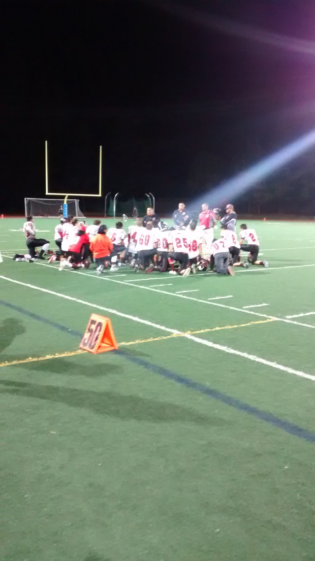 "Gunn footballers also known as ""14 Angry Men"" console themselves after tough loss Friday"