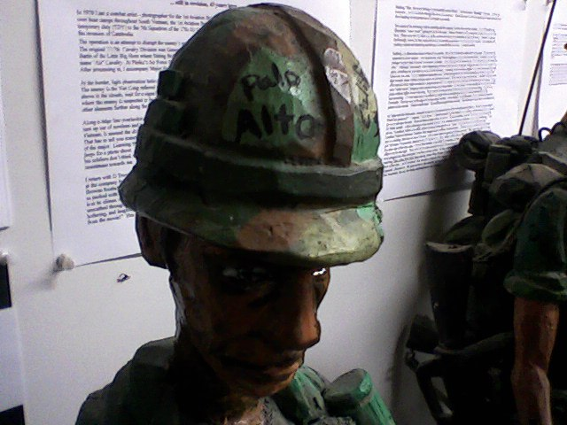 artwork by Jim Hardy, depicting a solider who had written PALO ALTO on his helm