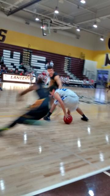 San Ramon guard Keith Smith and teammate harass Davis guard in full court press, in 99-62 romp at St. Francisco tourney Saturday