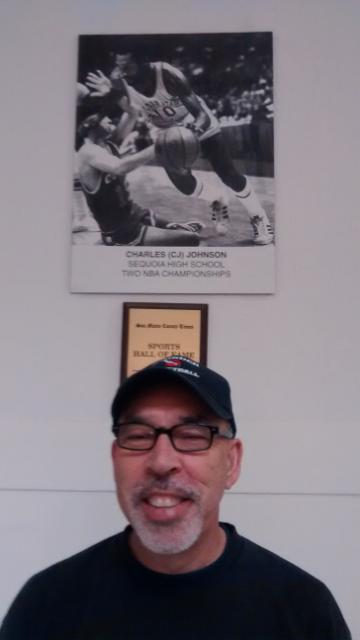 Gunn coach, Cubberley player and 2006 California coach of the year, Hans Delannoy, posing in front of Charles Johnson monument, Redwood City, California, February, 2015