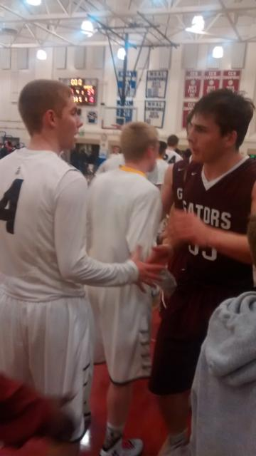 St. Francis Lancer Curtis Witt congratulates Sacred Heart Prep Andrew Daschbach after exciting 64-59 contest in CCS semifinals Tuesday at Independence High in San Jose.